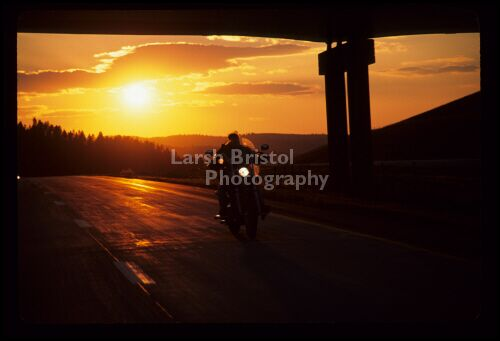 Motorcycle on road at Sunset