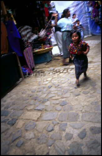 Child Plays at the Market