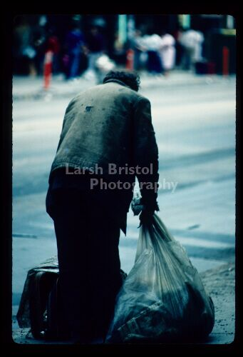 Man with Garbage Bag and Suitcase