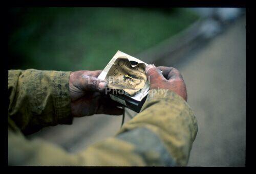 Fireman Holding Burned Clock